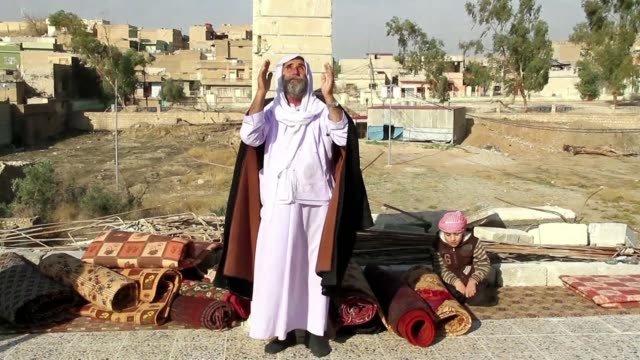 Northern Iraq's Yazidi community that suffered so terribly under Islamic State group persecution celebrated on Friday as it inaugurated a restored...
