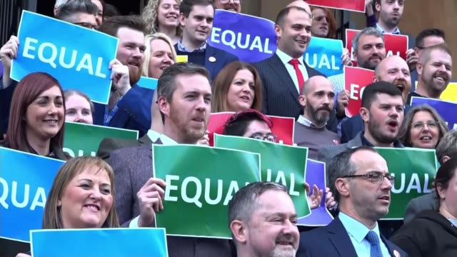 abortion and samesex marriage to be legalised northern various shots of proequal marriage campaigners with signs 'equal' and giant love heart and... - homosexual stock videos & royalty-free footage