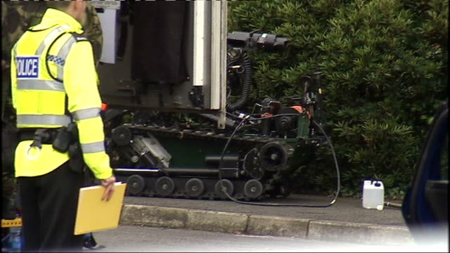 army major was car bomb target northern ireland county down bangor ext back views of police officers gaurding cordon as bomb disposal experts examine... - disposal stock videos and b-roll footage