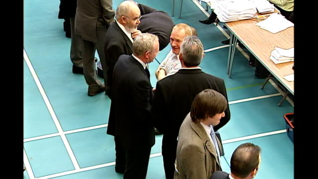 early results point to a powersharing government int martin mcguinness mingling with others as wait for ballymena count in sports hall bundles of... - martin mcguinness stock videos and b-roll footage