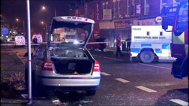 Belfast violence continues Loyalist gang throw petrol bomb into police car NORTHERN IRELAND Belfast Police patrol car outside office of Naomi Long...