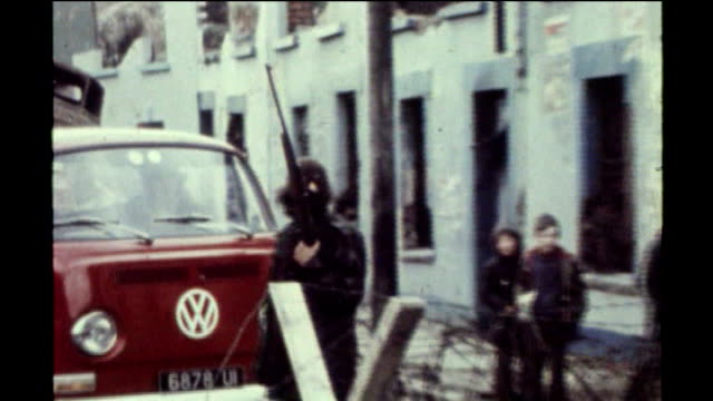 bloody sunday killings saville report exonerates bloody sunday victims 1972 masked ira gunman at roadblock as small boys watch ira gunman holding... - saville report stock videos & royalty-free footage