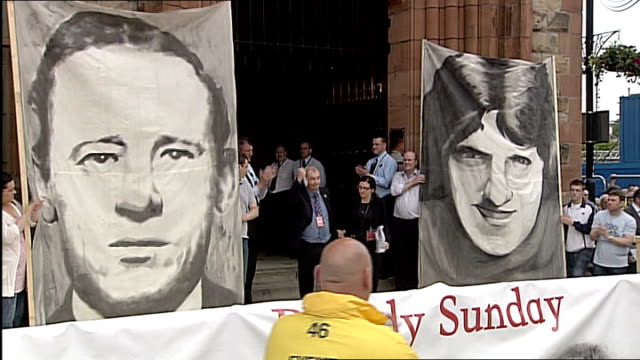 bloody sunday killings saville report exonerates bloody sunday victims families out of guildhall as along to microphone general view of crowd... - saville report stock videos & royalty-free footage