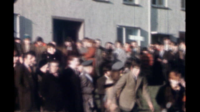bloody sunday killings: saville report to be published on tuesday 14th june 2010; lib various of massed civil rights association march along... - nordirland bildbanksvideor och videomaterial från bakom kulisserna