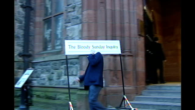 bloody sunday killings saville report to be published on tuesday 14th june 2010 2612004 / t26010403 official carrying bloody sunday inquiry sign... - saville report stock videos & royalty-free footage