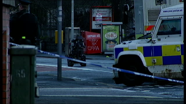 Bomb left outside Belfast shop NORHTERN IRELAND Belfast EXT Armed police officers in cordonedoff road Remote controlled bomb disposal robot in...