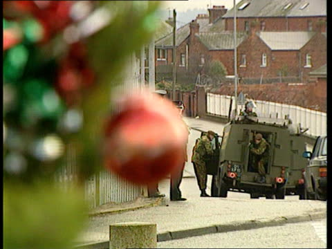 children sing carols on the peace line; northern ireland: n belfast: 'peace line': ext tlms group of catholic children singing carol sot pull out l-r... - carol singer stock videos & royalty-free footage