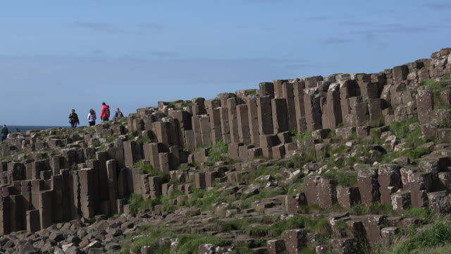 northern ireland columns of basalt on giants causeway pan - basalt stock videos & royalty-free footage