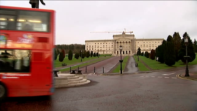 David Cameron and Enda Kenny fail to reach financial settlement deal NORTHERN IRELAND Belfast EXT Red double decker bus along past Stormont Side Shot...