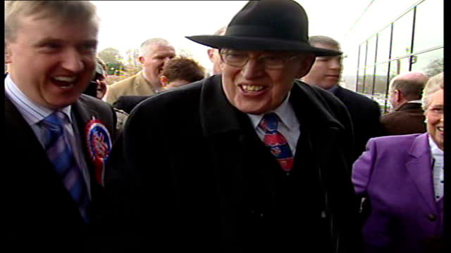 democratic unionists and sinn fein power sharing government belfast reverend ian paisley smiling as along through press surrounded by supporters and... - シンフェイン点の映像素材/bロール