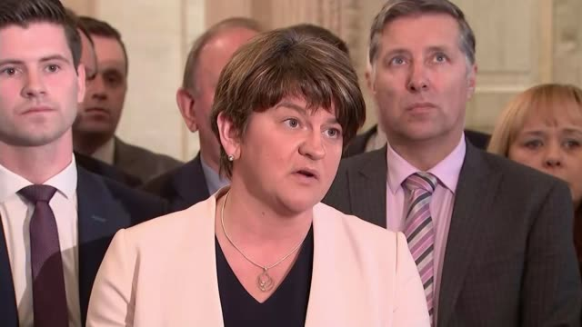 dup and sinn fein face stalemate at stormont northern ireland belfast stormont ext parliament buildings tilt down lock on gate clock in assemblies... - ストーモント点の映像素材/bロール