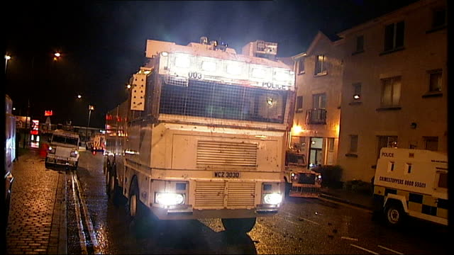 16 police officers injured in clashes armoured police truck reversing water jet being fired - itv weekend lunchtime news点の映像素材/bロール
