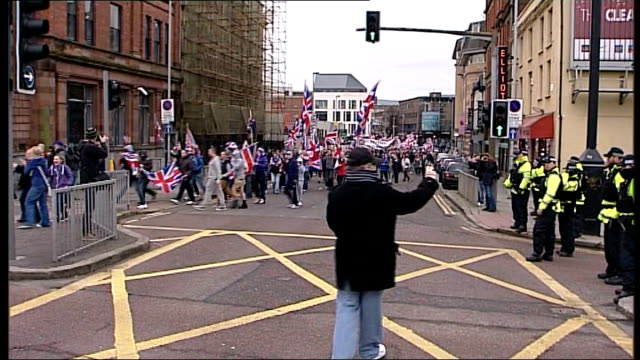 flag protests further violence in belfast northern ireland belfast ext loyalist demonstrators throwing missiles at riot police in foreground sound of... - northern ireland stock videos & royalty-free footage
