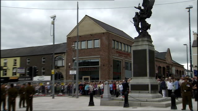 funeral held for gurkha soldier killed in afghanistan; northern ireland: county armagh: portadown: st mark's church of ireland: ext various of crowd... - county armagh stock videos & royalty-free footage