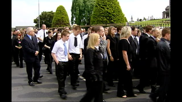 funeral of teenage boy believed to have committed suicide as part of pact; northern ireland: county armagh: laurelvale: ext coffin of lee walker... - county armagh stock videos & royalty-free footage