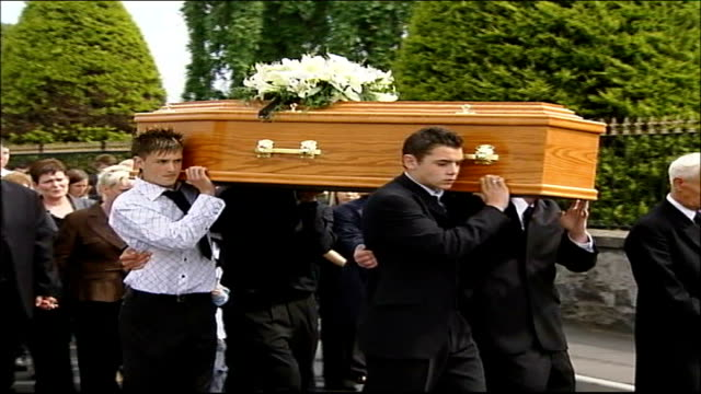 funeral of teenage boy believed to have committed suicide as part of pact northern ireland county armagh laurelvale ext coffin of lee walker carried... - county armagh stock videos and b-roll footage