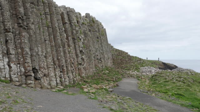 northern ireland giants causeway path and columns - basalt stock videos & royalty-free footage