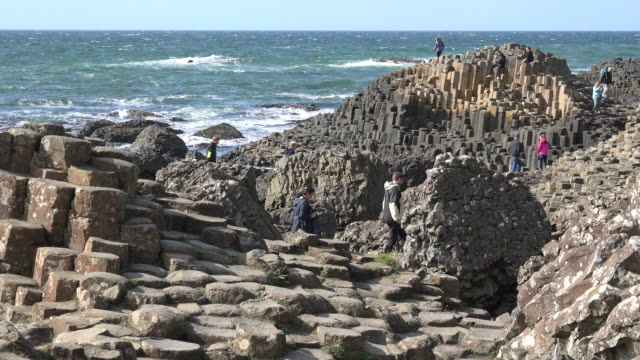northern ireland giants causeway people exploring at site - rock stock videos & royalty-free footage