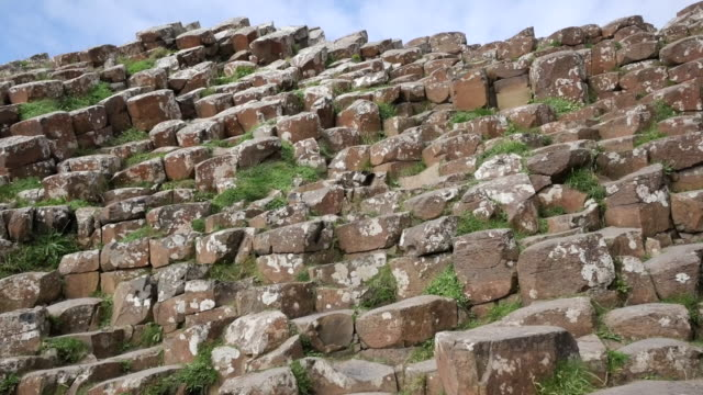 northern ireland hexagonal columns with lichens at giants causeway - rock formation stock videos & royalty-free footage
