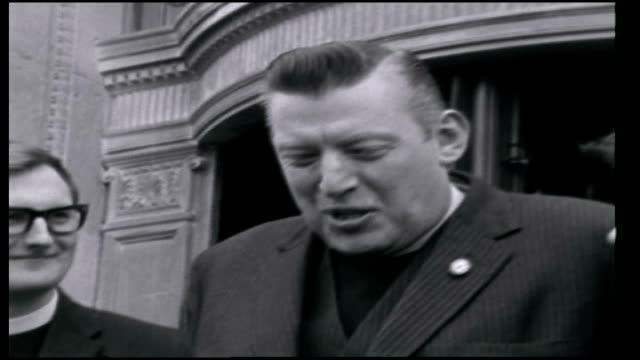 ian paisley takes seat at the northern ireland parliament 22nd april 1970 ireland belfast ext reverend ian paisley talking to supporters before... - イアン ペイズリー シニア点の映像素材/bロール