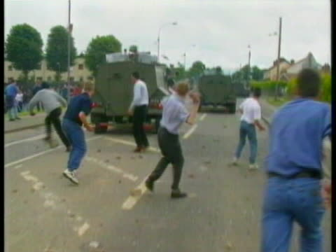northern ireland locals throw large stones and rocks at an armored vehicle in portadown during the drumcree conflict - camouflage stock videos & royalty-free footage