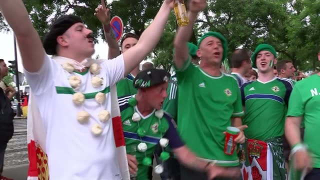 northern ireland loses to germany france paris parc des princes ext various shots northern ireland fans dressed in green and celebrating northern... - 2016 stock-videos und b-roll-filmmaterial