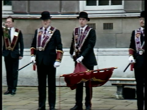 loyalist march; northern ireland / ulster: belfast: ext tgv loyalists marching towards tms pipers in uniform playing as past l-r sof tgv march... - traditional clothing stock videos & royalty-free footage