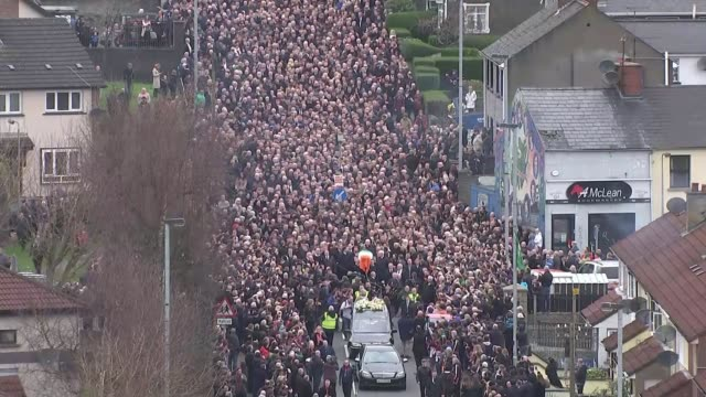 martin mcguinness funeral northern ireland derry / londonderry ext various of coffin of martin mcguinness carried along behind hearse through bogside... - gerry adams stock videos and b-roll footage