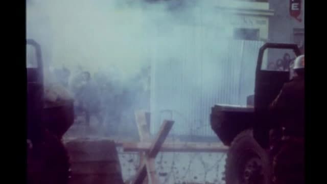 martin mcguinness funeral s27110601 3011972 derry / londonderry ext bloody sunday british soldiers firing tear gas in direction of demonstrators... - 1972 stock videos & royalty-free footage