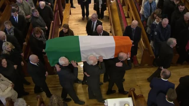 martin mcguinness funeral st columba's church int martin mcguinness coffin carried along aisle at funeral service - martin mcguinness stock videos and b-roll footage