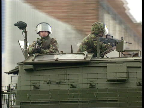 More troops shipped in ITN IRELAND Belfast MS APCs along CMS APC along PAN LR BV Soldier on APC aiming away CMS Soldier taking aim MS Soldier along...