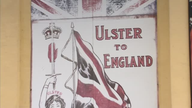 murals northern ireland belfast ext various shots of murals for uvf spb flags on wall / shankill road banners / people along in street / rhc mural /... - northern ireland stock videos & royalty-free footage