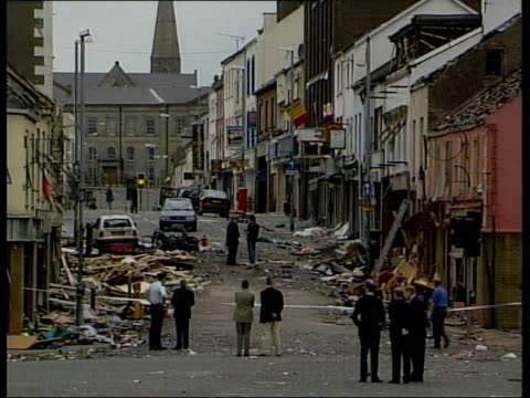 omagh bomb itn ireland county tyrone omagh ext gv emergency services amp army vehicle at site where car bomb exploded with police cordon in f/g gv... - bombing stock videos & royalty-free footage