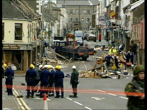 omagh bombing; h)c4n northern ireland: omagh: tms brooms being used to sweep up broken glass and other debris from pavement gv bomb site with clear... - krishnan guru murthy stock videos & royalty-free footage
