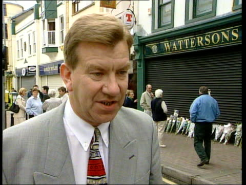 omagh bombing northern ireland county tyrone omagh int stanley mccombe interviewed high street 2 shot wesley atchison interviewed as we stand here... - lying on front stock videos & royalty-free footage