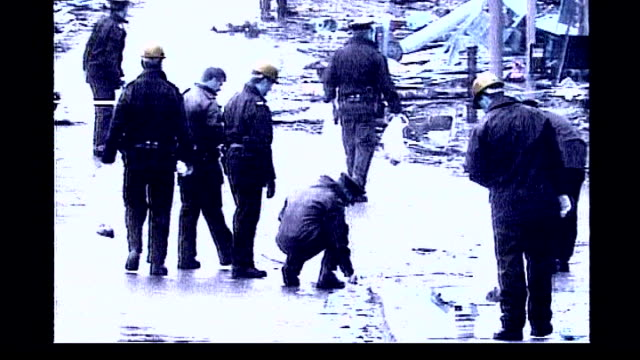 omagh bombing trial sean hoey acquitted of murder tx ireland county tyrone omagh ext graphicised seq police officers searching for evidence amongst... - bombing stock videos & royalty-free footage