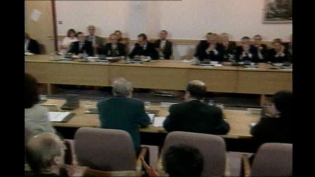 northern ireland peace process: continued paramilitary activity; lib delagates applaud during good friday agreement talks - including gerry adams mp... - mp点の映像素材/bロール