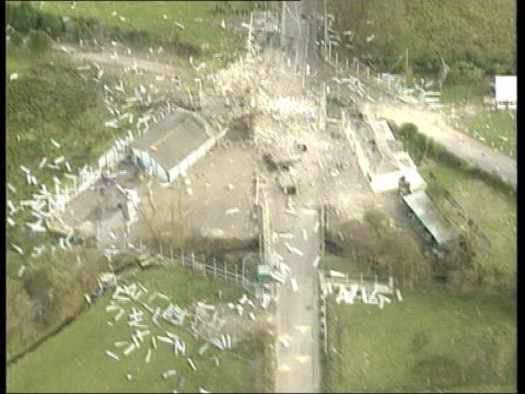 devolution negotiations lib coshquin aftermath of ira bomb at security checkpoint air view debris on ground from bomb explosion soldiers at... - northern ireland stock videos & royalty-free footage