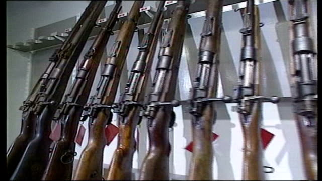 ira decommissioning questioned date decommissioned guns on rack in room/ decommissioned gun is cut up with mechanical saw - northern ireland stock videos & royalty-free footage
