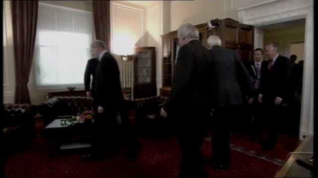 new powersharing government sworn in northern ireland belfast stormont int martin mcguinness mla speaking in corridor with dr ian paisley mla... - バーティ アハーン点の映像素材/bロール