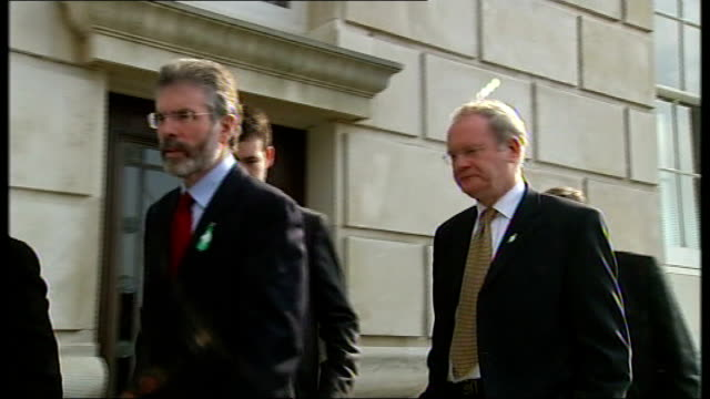 northern ireland powersharing agreement made stormont ext adams mcguiness and others along into building - ストーモント点の映像素材/bロール