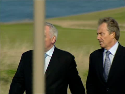 talks at st andrews leaders arriving on foot scotland st andrews fairmont hotel ext tony blair mp and bertie ahern along past golf links course to... - golf links stock videos and b-roll footage