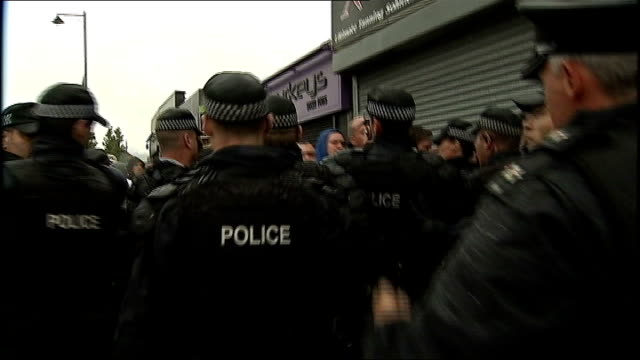 police appeal for calm following violent rioting in belfast; group of women cheering and waving flags group of women dressed in red, white and blue... - pavement点の映像素材/bロール