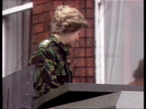 princess of wales visit; dark sky/wind n ireland: londonderry: ebrington barracks: cms princess of wales, wearing combat gear, along r-l pull out as... - tag 1 stock-videos und b-roll-filmmaterial