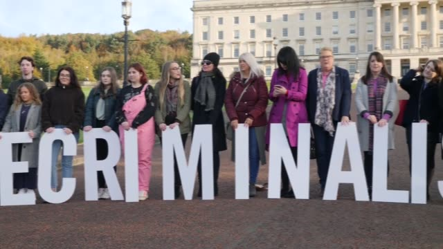 pro and ant-abortion protests outside stormont; northern ireland: belfast: stormont: ext various shots of pro-choice abortion protesters standing... - abortion stock videos & royalty-free footage