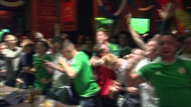 northern ireland qualify for euro 2016; int northern ireland fans celebrating goal as watching match in pub - nordirland bildbanksvideor och videomaterial från bakom kulisserna