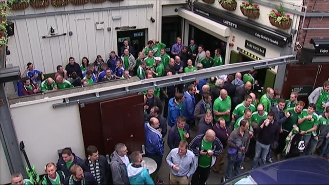 northern ireland qualify for euro 2016 northern ireland belfast ext various of northern ireland football fans standing drinking outside pub /... - drinking stock videos & royalty-free footage