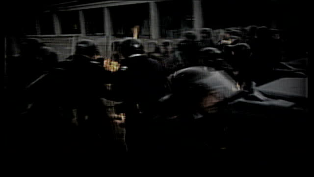 report reveals police officers shielded loyalist killers; date unknown: northern ireland: belfast ext graphicised seq b/w slow motion clashes between... - loyalty stock videos & royalty-free footage