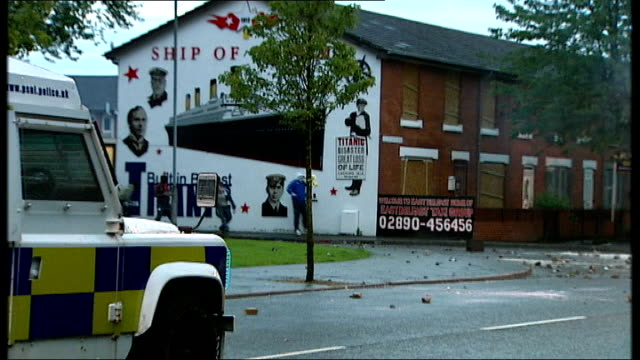 rioters clashing with police in east belfast police vans advancing as pelted with rocks by rioters / rioter climbing on bonnet of van as other man... - molotov cocktail stock videos and b-roll footage