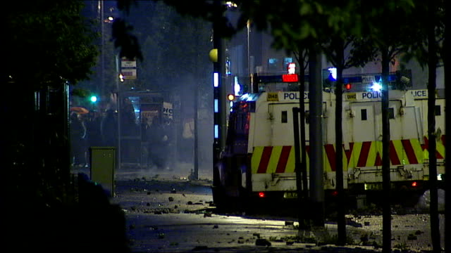 rioters clashing with police in east belfast riot policeman hanging out of back of van / vans with rioters at far end of street / more of vans / more... - molotov cocktail stock videos and b-roll footage